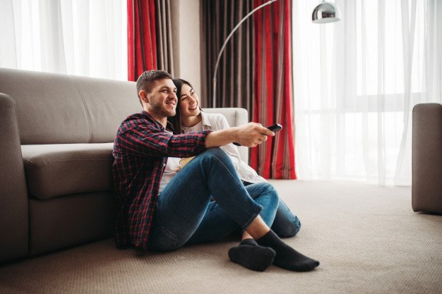 Couple watching TV in Condo in Manila